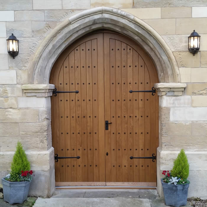 Solid Arched Church Door by Merrin Joinery